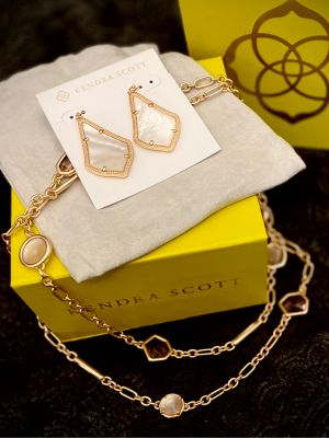 Kendra Scott Rose Gold necklace and earrings in Ivor...
