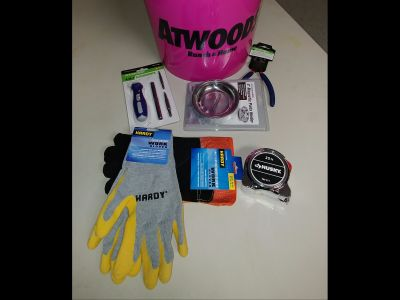 Pink Atwoods bucket with various items