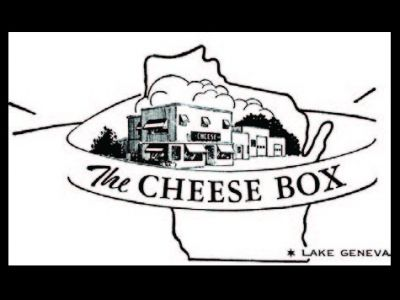 BASKET-  $15 gift certificate to The Cheese Box + Cheese Slicer